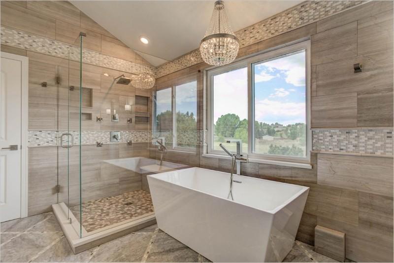 beige wall tiled wall porcelain floor chandelier freestanding tub glass siding