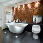 Ceiling Lights Drama Ligts Tiled Wall Textured Wall Tiled Floor Freestanding Tub Toilet Wooden Cabinet White Countertop