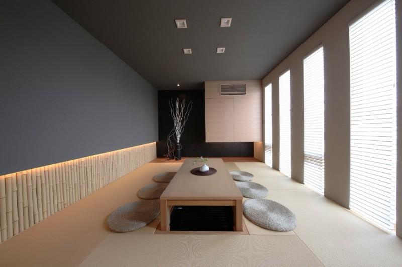 japan style dining table bamboo rail wall grey wall grey floor cushions floor decoration windows grey ceiling window shades brown floor