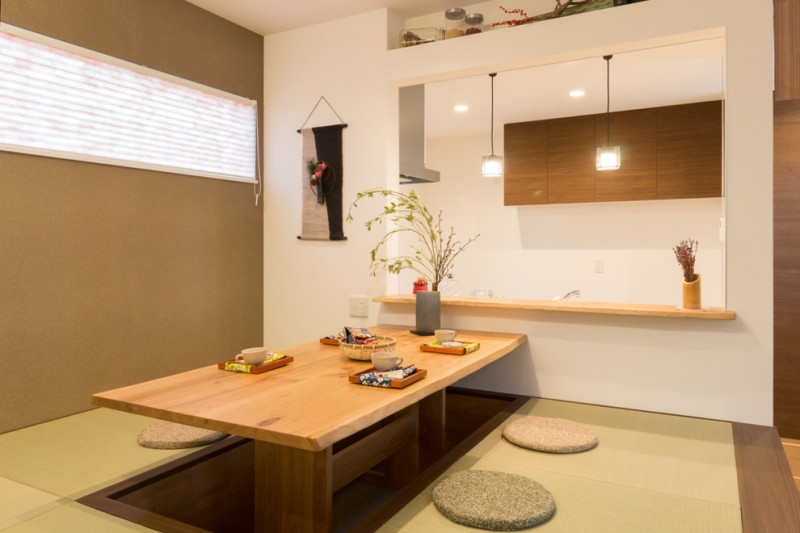 japan style dining table big mirror round floor cushions brown wall window with shade beige area rug pendant lamps wall decor mounted shelf