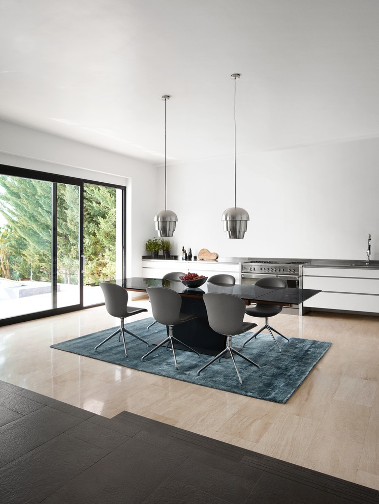 japan style dining table black dining table grey chairs blue shag rug silver pendant lamps sliding glass windows stove white kitchen cabinet
