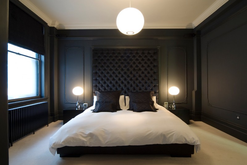 mansion master bedroom bespoke deep buttoned velvet headboard in black black painted panelling black nightstands chandelier