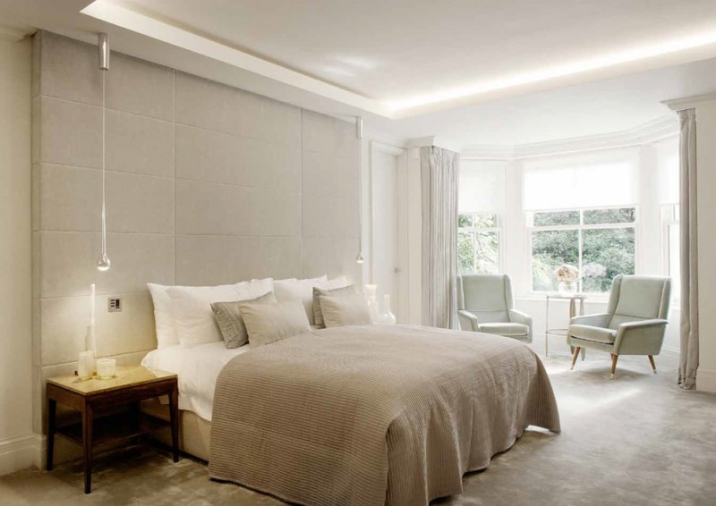 mansion master bedroom glass pendant lamps wooden side tables tray ceiling bay windows armchairs beige wall curtains