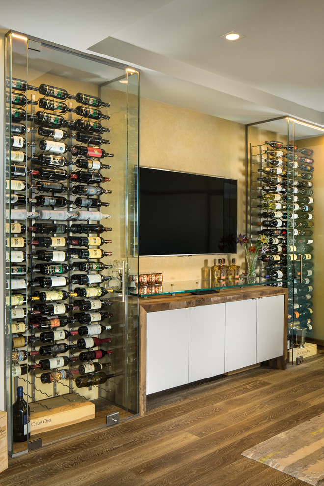 modern wine cellar glass wine cellars wine racking system wooden console wall mounted tv yellow wall wooden floor
