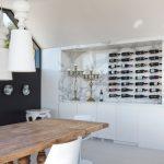 Modern Wine Cellar Marble Wall Clear Glass Wine Cellar Wine Peg Rack Wine Bottles Wooden Table White Chiars Pendant Lamps