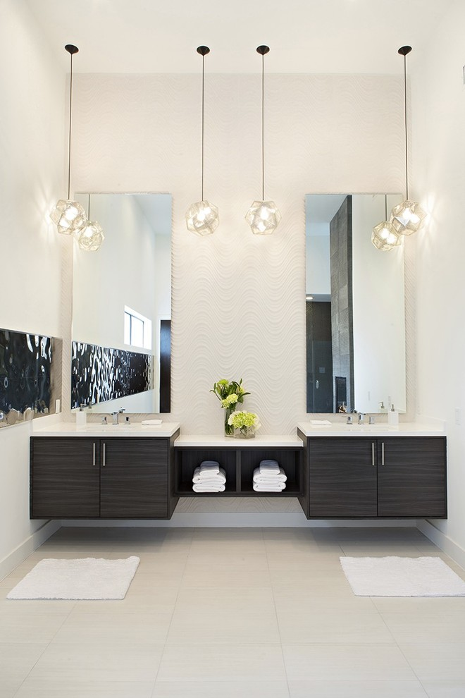 pendant lights chromatic lights concrete wall floating cabinet dark stained cabinet drop in sink tiled floor