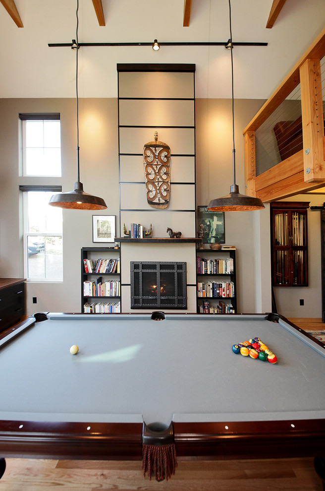 pool table pendant lights fireplace fireplace upholster artistic decoration book shelves track lights exposed beams windows