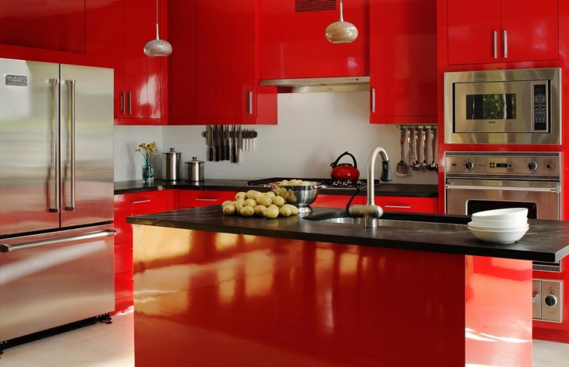 red and black kitchen black countertops red cabinets red island sink faucet refrigerator oven stovetp range hood