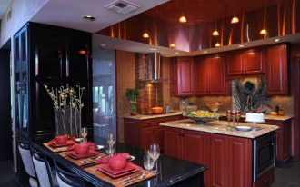 red and black kitchen red cabinets red island black mounted table barstools black cabinets backsplash stovetop range hood oven