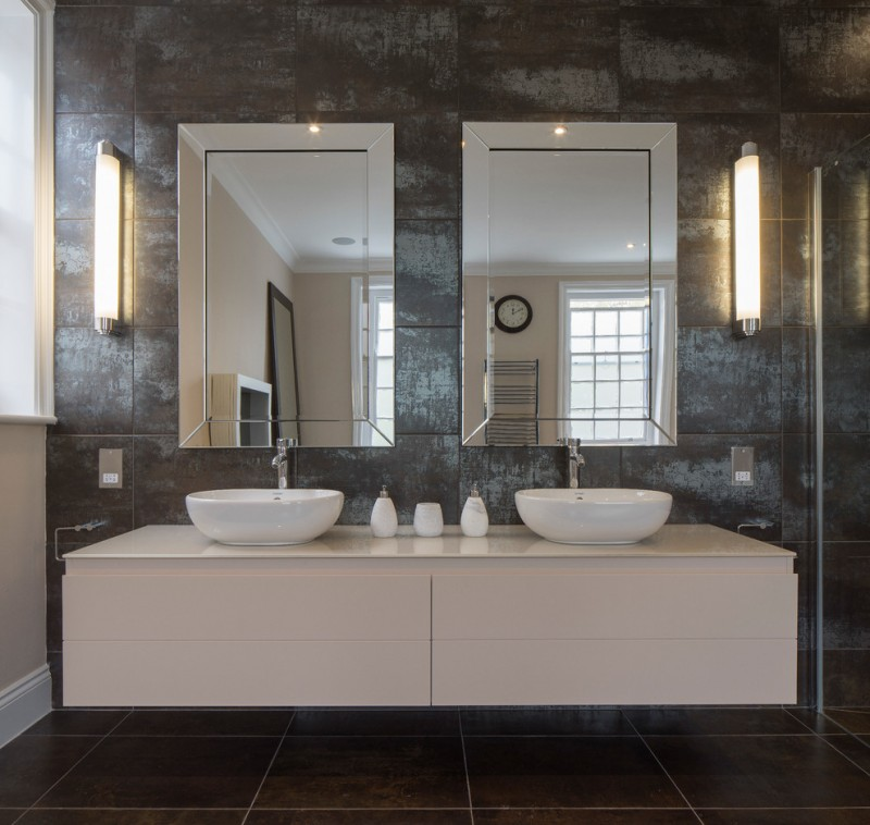bathroom vanity refacing mirrors grey textured wall wall sconces white sink bowl white floating vanity glass shower