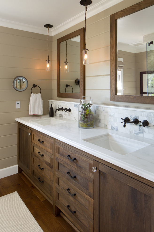 bathroom vanity refacing stained wood vanity white top backsplash black wall mouted faucets glass pendant lamps mirrors