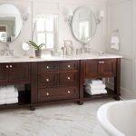 Bathroom Vanity Refacing Wooden Vanity Drawers Open Shelving Mirrors White Tub Wall Sconces Marble Top Windows Towel Rings