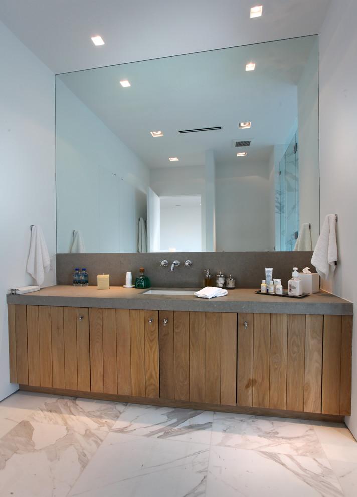 bathroom vanity refacing wooden vanity stone top large mirror recessed lighting sink wall mounted faucet hand towels