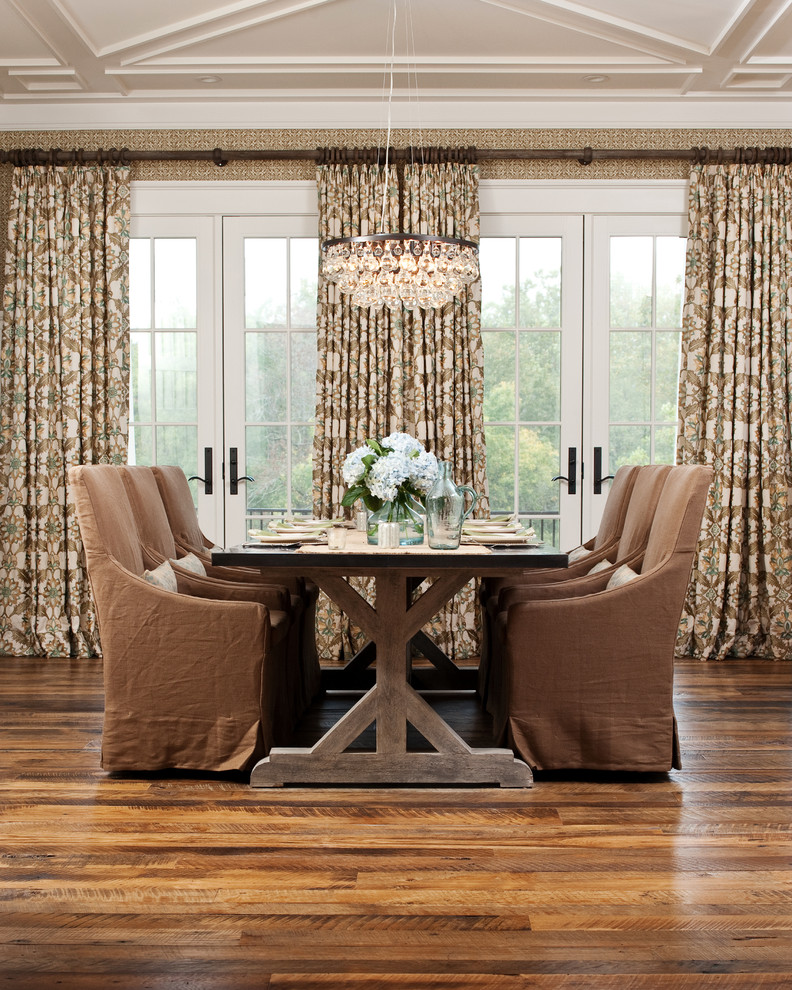brown dining room chair covered armchair wooden dining table black top crystal chandelier white glass doors curtains