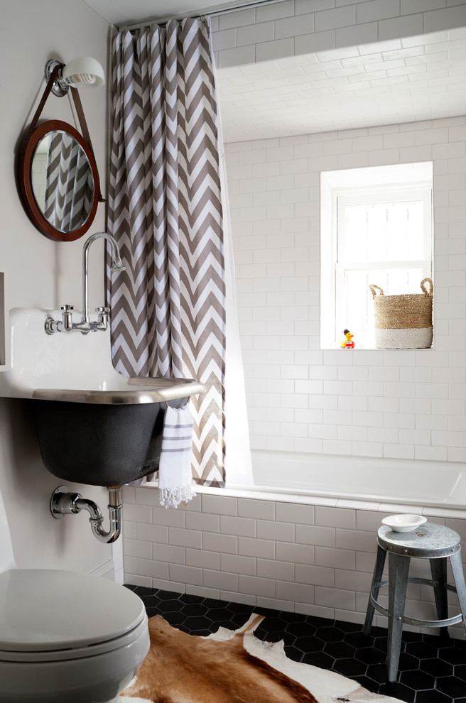 ceiling track shower curtain chevron curtain hand towel white wall tile bathtub window stool cowhide rug black tile sink mirror