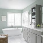Double Vanity Wall Mirror Grey Shelves White Top White Sinks Faucets Mirrored Cabinets Wall Sconces Bath Tub Window