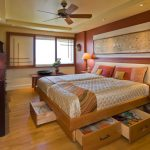 Full Storage Platform Bed Shimmery Beige Bedding Ceiling Fan With Lighting Table Lamps Nightstands Sliding Windows