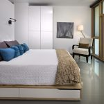 Full Storage Platform Bed White Drawers Wooden Bed Frame White Cupboard Wall Sconce Armchair Blue And Purple Pillows Window