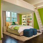 Green Bedroom Walls Built In Shelves Beige Bed Headboard Blue Shag Ottoman Shag Rug White Desk White Chair Curtains Windows