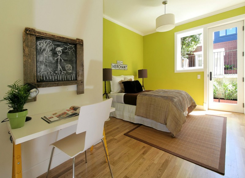 green bedroom walls chalkboard white bed brown table lamps area rug white desk chair ceiling lamp glass window glass door