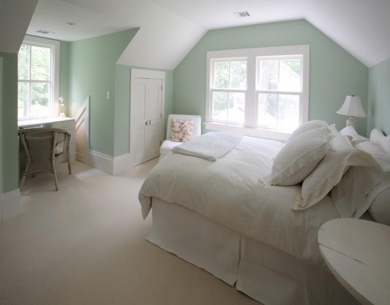 green bedroom walls windows white bed white table lamp white desk rattan chair white bedding white pillows white chair side table