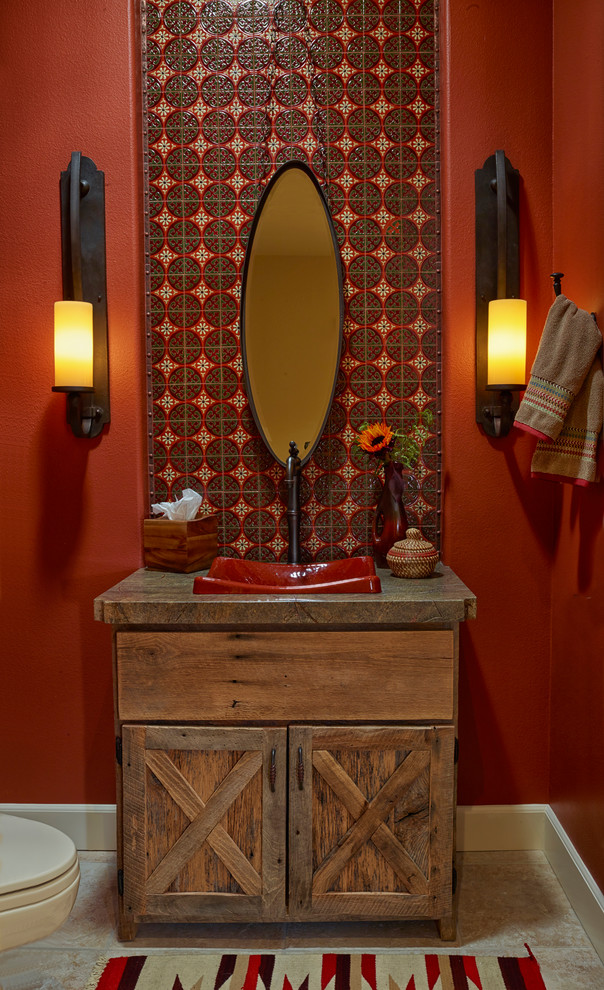 iron mirror frame iron wall sconces wooden vanity red sink oval mirror faucet bathroom mat red wall towel holder