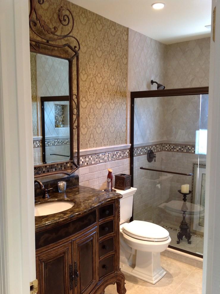 iron mirror frame wooden vanity beige wallpaper beige bathroom tiles glass shower door shower head white sink