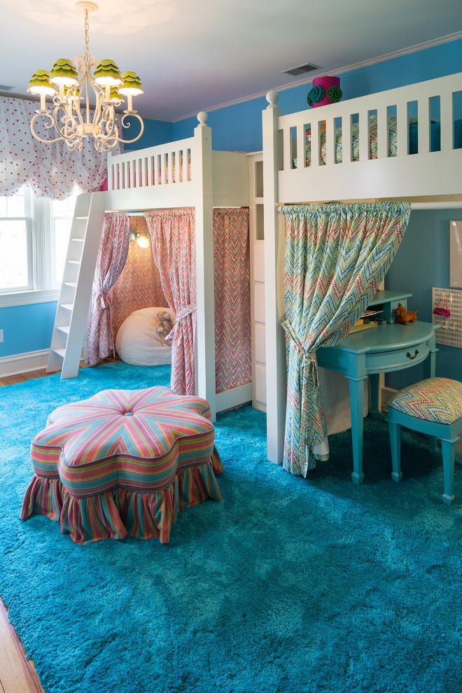 kids white loft bed chandelier blue shag rug colorful ottoman pink and blue drapes bean bag blue desk stool window