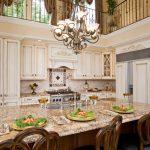 Kitchen Stool Chandelier Swivel Stool Beige Granite Countertops Sink Faucet Backsplash White Kitchen Cabinets Stove