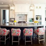 Kitchen Stool Pendant Lamps Black Island White Cabinets Backsplash Granite Countertops Sink Faucet Stove Oven Wooden Floor