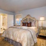 Large Ornate Mirror Bed Headboard Mirrored Side Tables Mediterraneadn Rug Window Table Lamps Artwork Patterned Window Shade