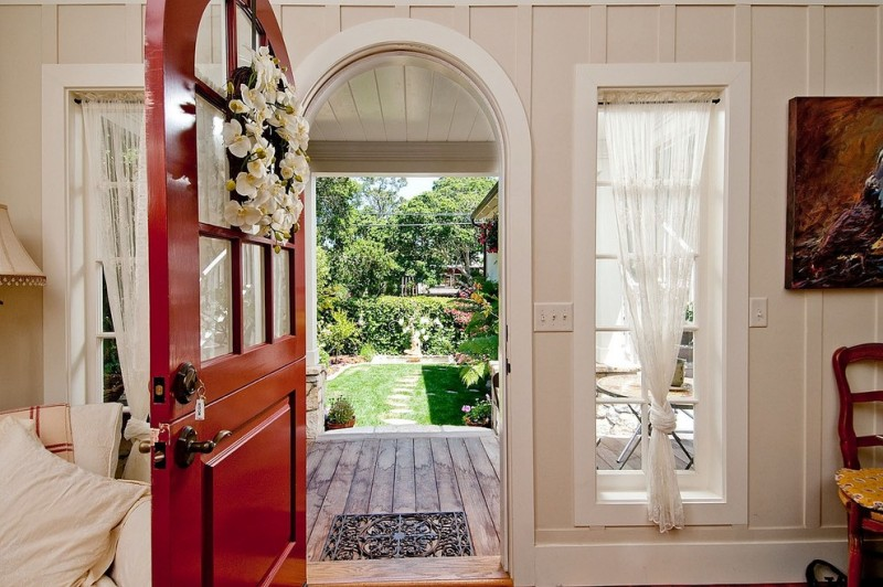 red door designs dutch door flowers decoration white glass windows white curtains wooden floor red chair artwork table door handle knob