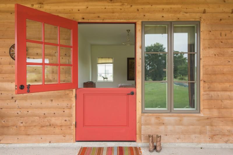red door designs glass grid doors glass windows wooden reclamed wall grey concrete floor pedant lamp colorful outdoor mat