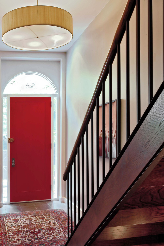 red door designs pendant lamp red mediterranean area rug glass windows white walls artwork wood staircase railing