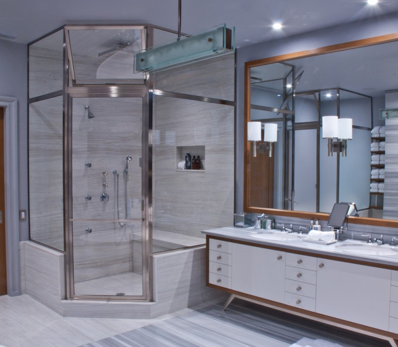 regal glass shower glass doors built in bench wooden framed mirror white vanity drawers grey floor wall sconces