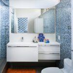 Sliding Glass Shower Door Blue Mosaic Wall Tiles White Floating Vanity Sink Faucet Mirror Orange Mat Drawers Shower Head