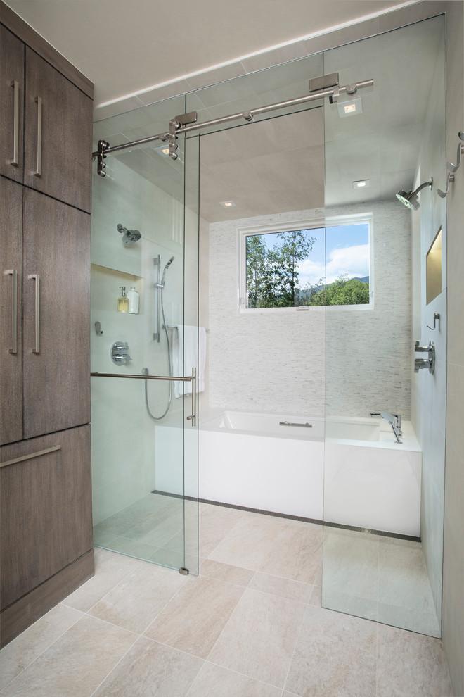 sliding glass shower door frameless glass door white bathtub window brown cabinets shower head beige floor tiles