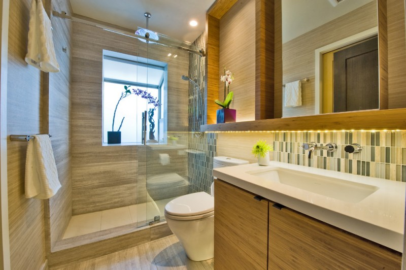 sliding glass shower door frosted glass window rain shower head towel holders wooden vanity white sink mirror backsplash