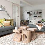 Small Coffee Table Wooden Sculptural Coffee Table Area Rug Dark Grey Sofa Dark Grey Bench Colorful Pillow Floor Lamp