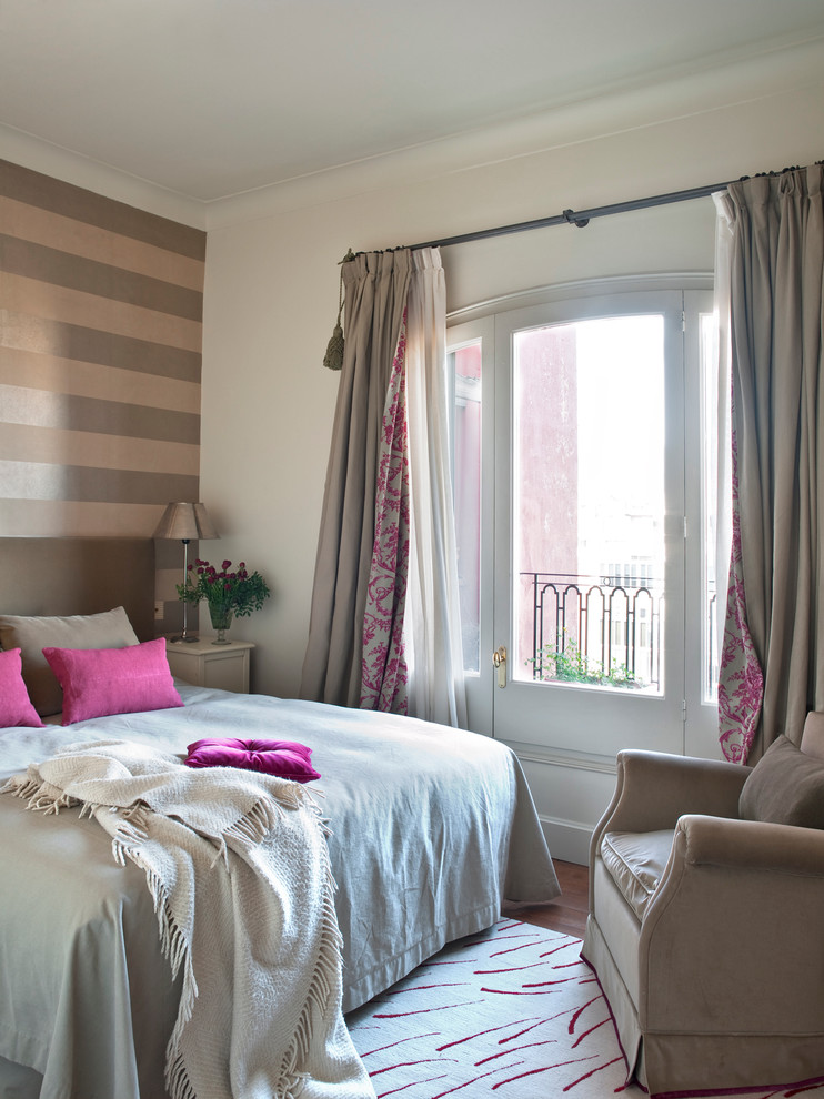 striped wall painting brown striped wall bed pink pillows brown armchair white area rug white windows white door curtains