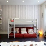 Toddler Boys Bed Bunk Bed Ladder Cow Hide Rug Red Floor Couch Pillows Striped Wallpaper Built In Shelves Windows