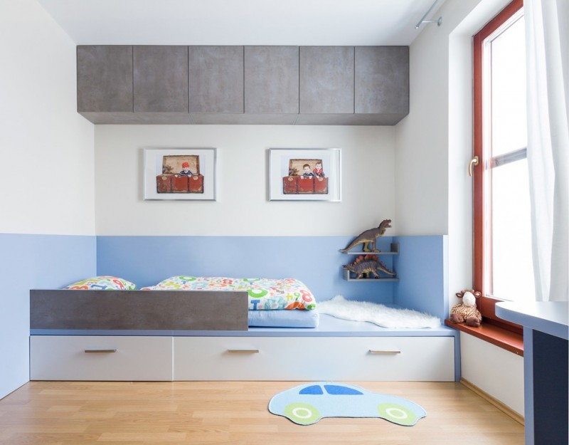 toddler boys bed platform bed drawers knobs grey cabinets window white curtain window bench wall decor colorful bedding