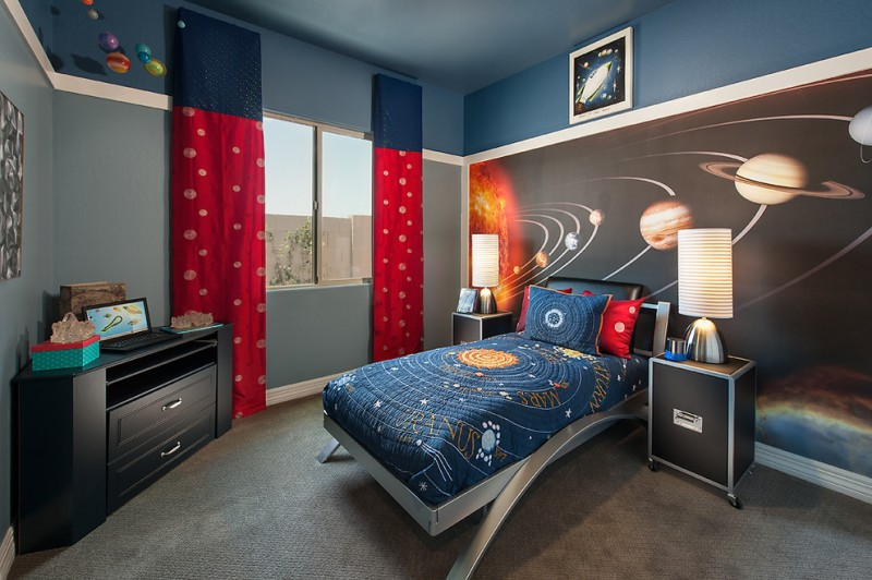 toddler boys bed space theme red curtains blue bedding black nightstands drawers grey carpet wall mural table lamps