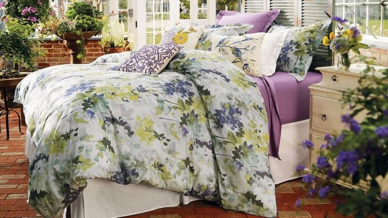 watercolor duvet floral bedding white bed rustic white nightstands brick floor indoor plants headboard glass windows
