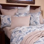 Watercolor Duvet Pink Blue White Bedding Colorful Pillows White Table Lamps Wooden Headboard Wooden Nightstands