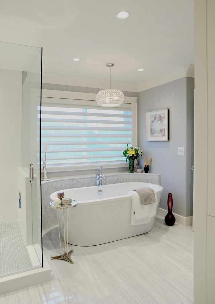 acrylic freestanding bathtub chandelier window blind grey wall glass side table tub filler glass shower door glass flower vase