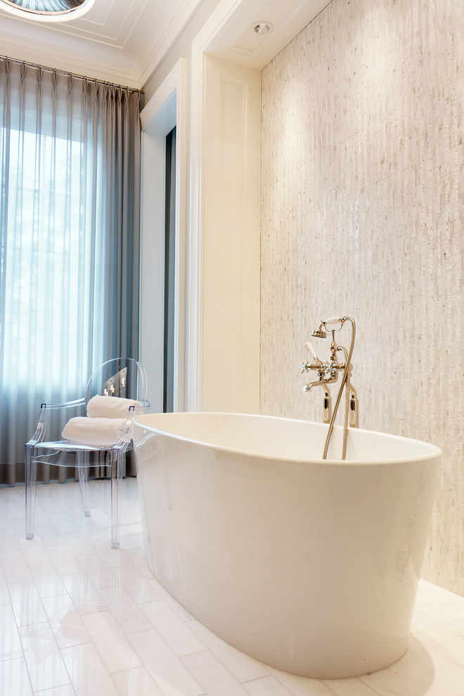 acrylic freestanding bathtub ghost chair white towels tub filler glazed wall tile white floor tile window grey curtains