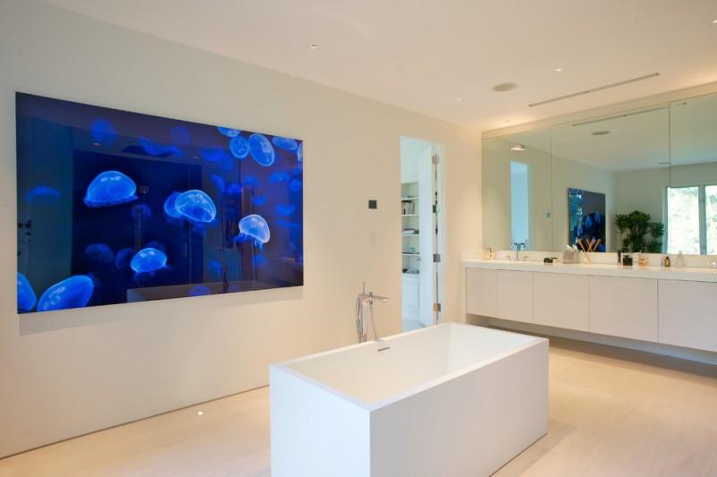 acrylic freestanding bathtub jellyfish tank white vanity double sink faucet mirror tub filler white floor tile recessed lighting