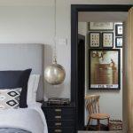 Antique Silver Pendant Light Black Drawers Blue Bedding Headboard Blue Pillows Wooden Chairs White Walls Artwork Blue Trim
