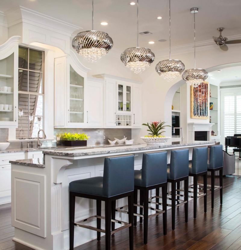 antique silver pendant light white cabinets white island sink grey granite countertop wooden floor blue bar stools shelves stove